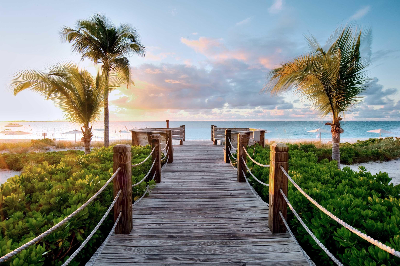 Grounds Resort Scenic views sky tree water walkway shore Beach plant River Ocean Coast Sea arecales morning boardwalk palm family tropics sunlight palm lined