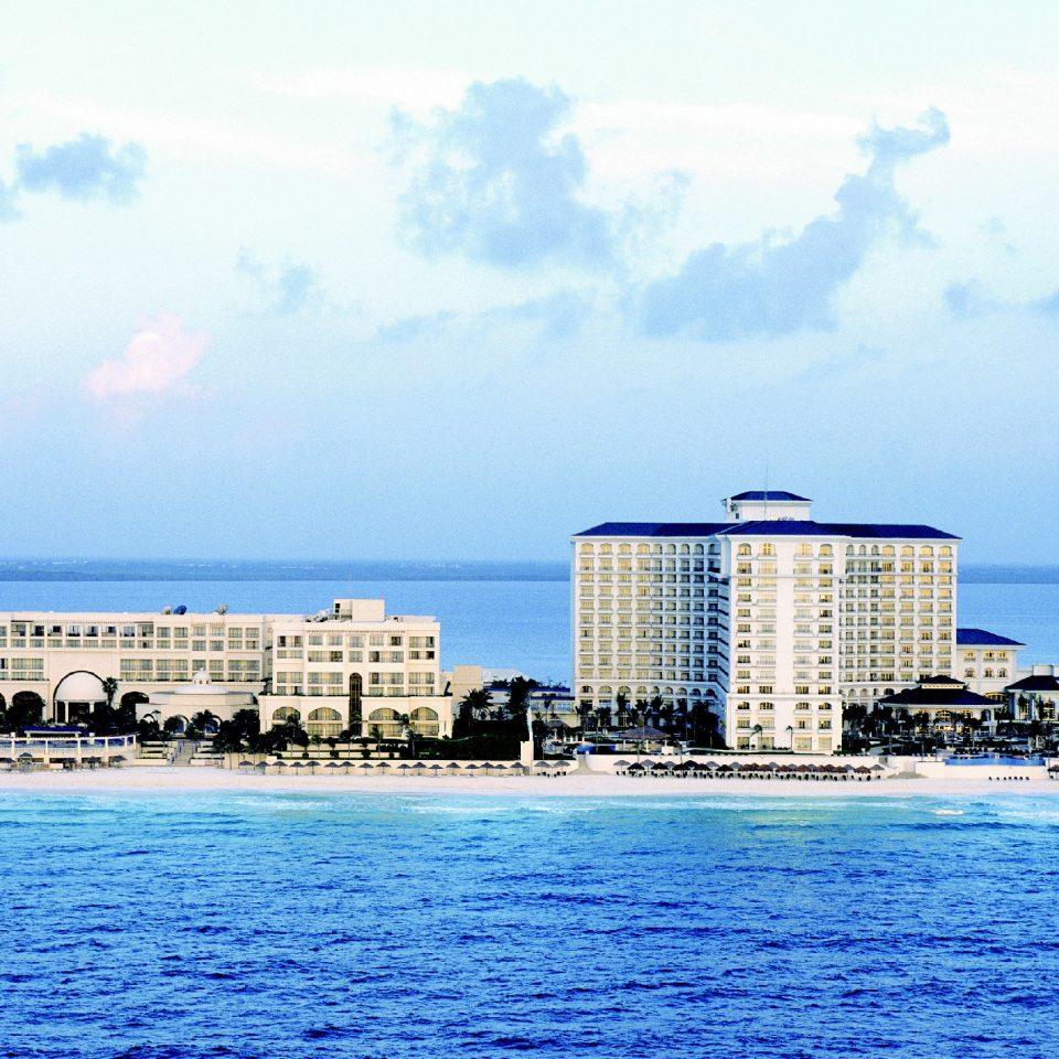 sky water scene horizon Harbor Sea Ocean Coast skyline Beach shore pier tower dusk cityscape dock blue