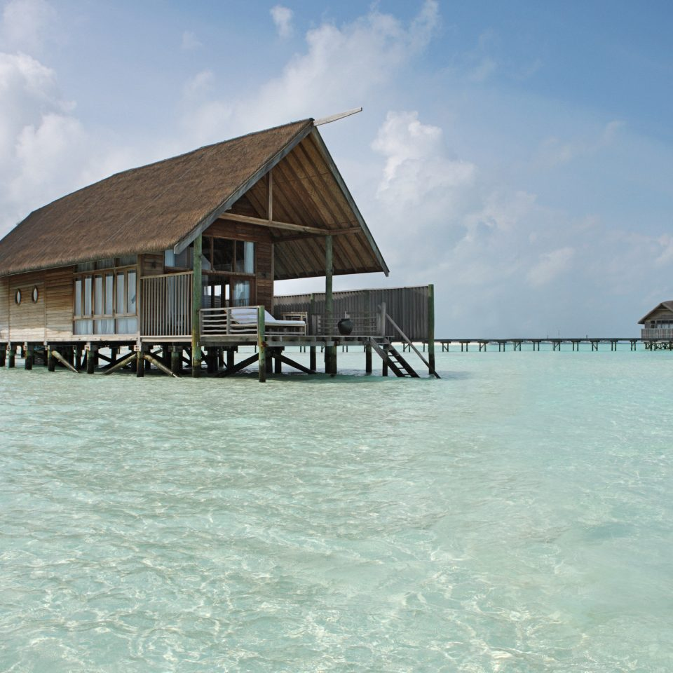 Honeymoon Luxury Overwater Bungalow Romance Romantic Tropical Waterfront sky water Beach Sea house Ocean Resort Island Coast vehicle caribbean Lagoon shore