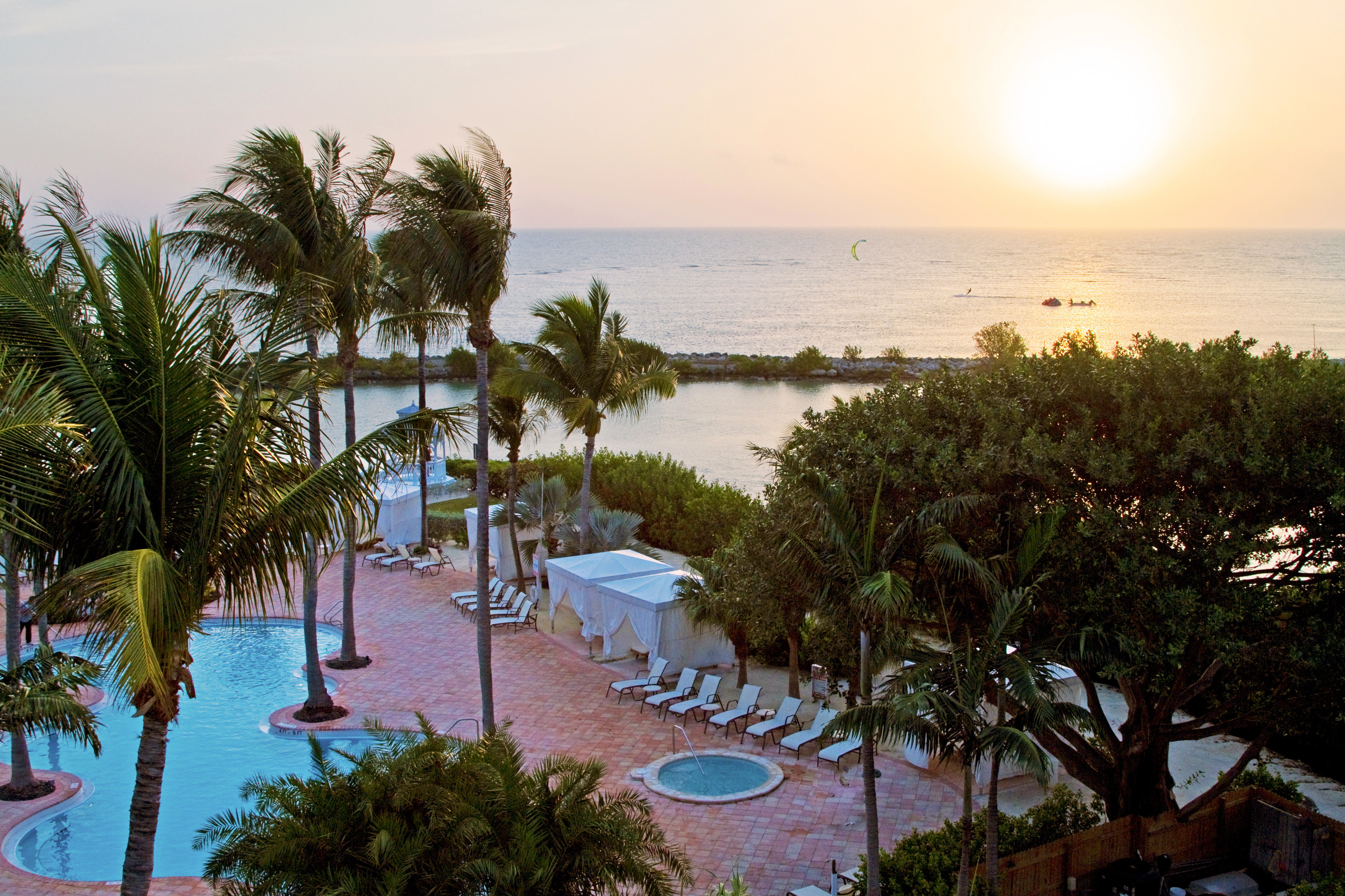 Hot tub/Jacuzzi Lounge Pool Resort tree sky water Beach arecales Ocean Sea plant caribbean Nature Coast palm shore overlooking sandy