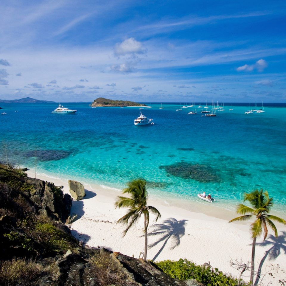 Hotels sky water Beach Sea Nature Coast shore Ocean caribbean wind wave cape Island tropics islet wave Lagoon sand cove terrain day sandy