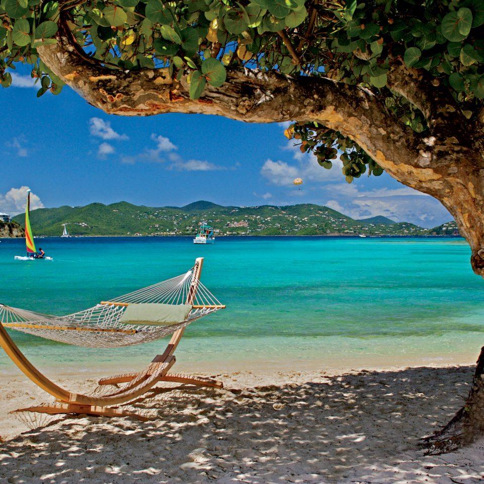 Beach Hotels Romance Rustic Tropical water shore tree Sea Nature Ocean tropics Coast Island caribbean Lagoon arecales