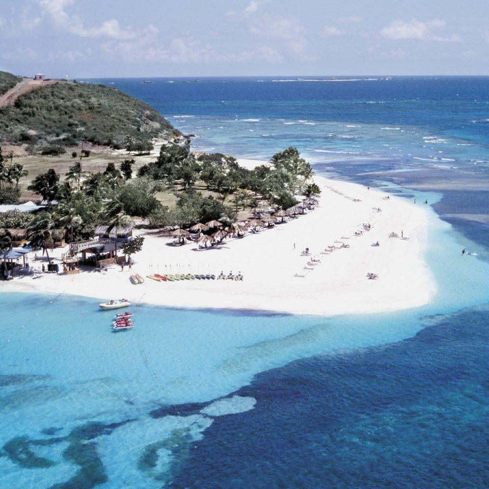 Hotels water sky Nature reef Coast Sea Ocean mountain Beach shore islet cape Island archipelago caribbean cove Lagoon terrain aerial photography