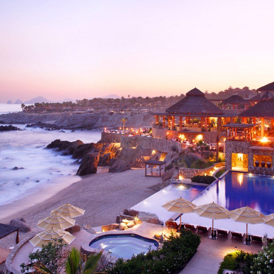 Hotels Romance sky water Resort Beach evening Sea Coast Nature dusk Sunset