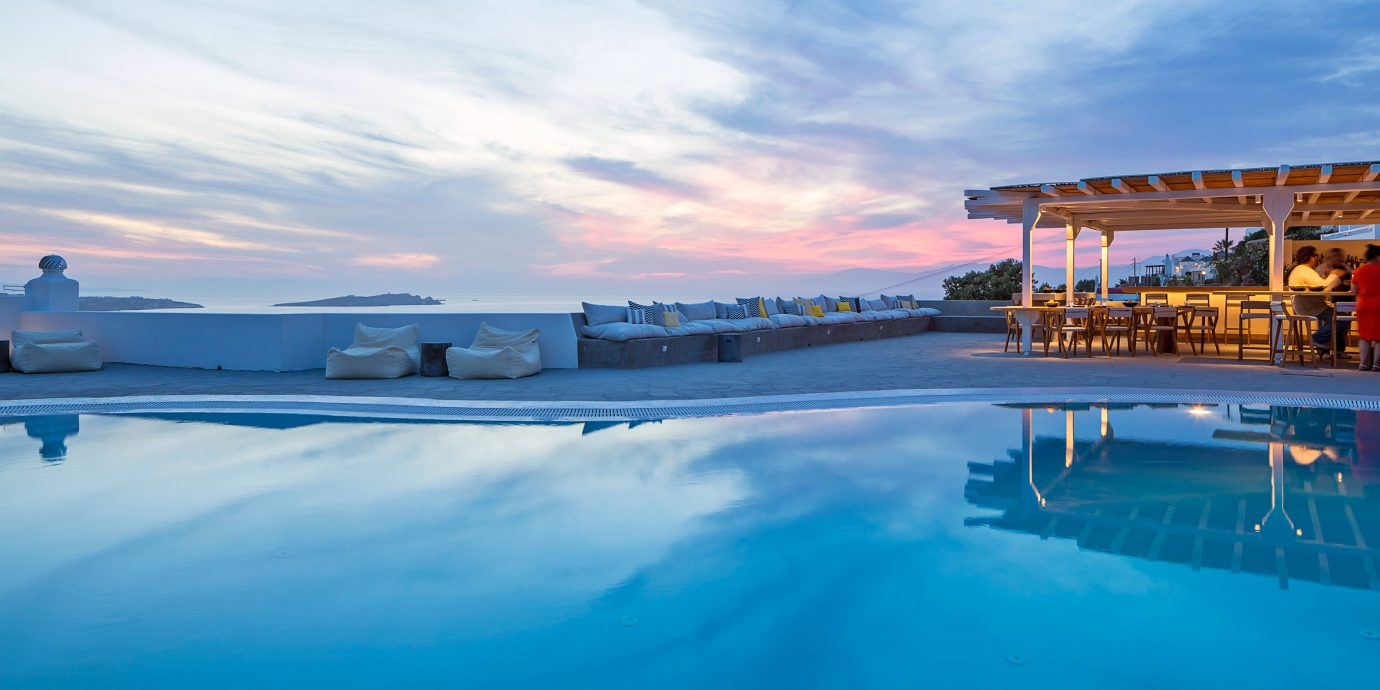 Hotels sky water Sea swimming pool Ocean scene horizon shore Coast dusk Beach blue day