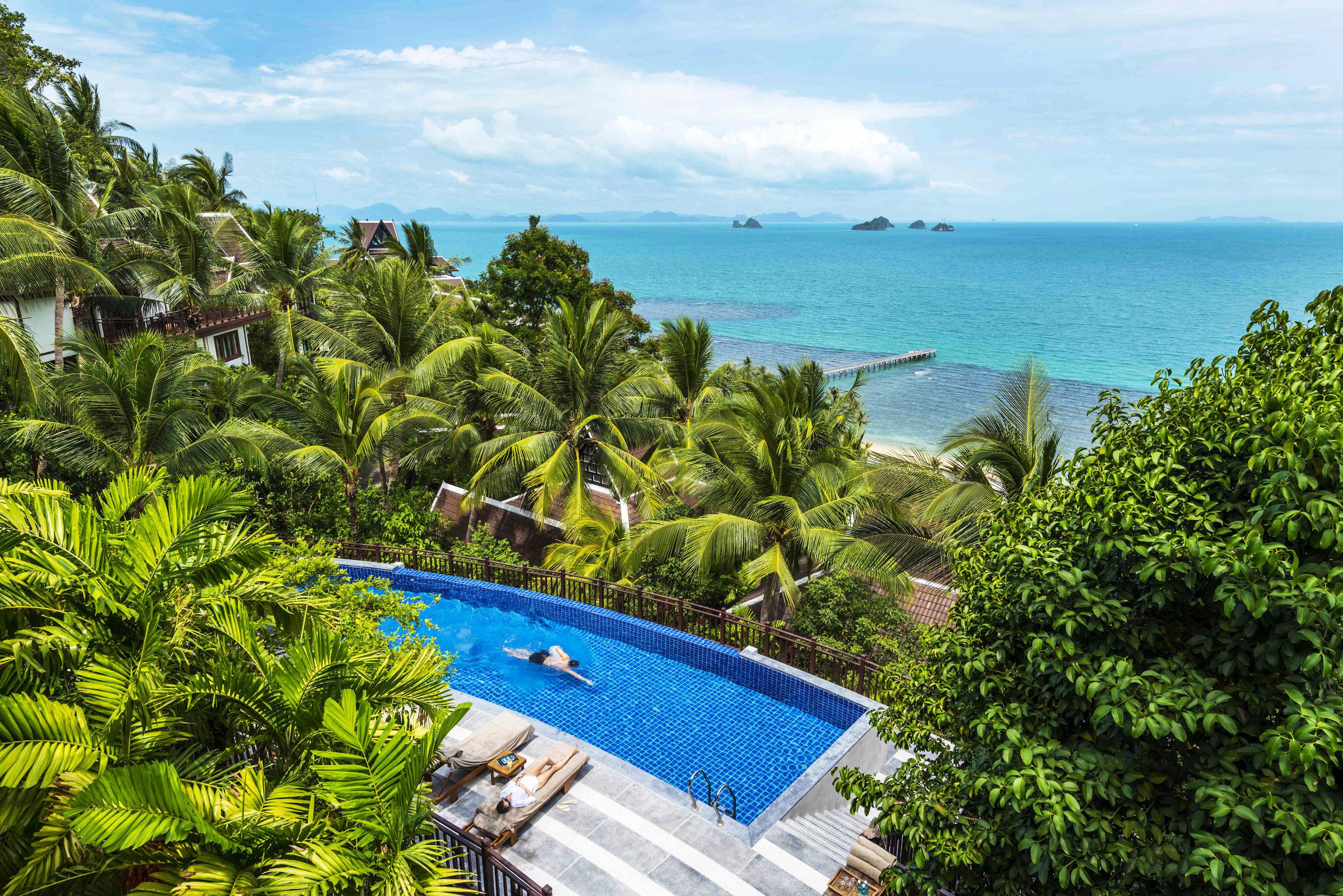 tree water caribbean property Resort tropics Sea Beach Coast Ocean swimming pool Villa Lagoon Island Jungle arecales blue plant overlooking