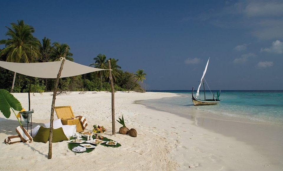 sky Beach water Sea shore caribbean Ocean sand sandy Coast Island Lagoon Resort day