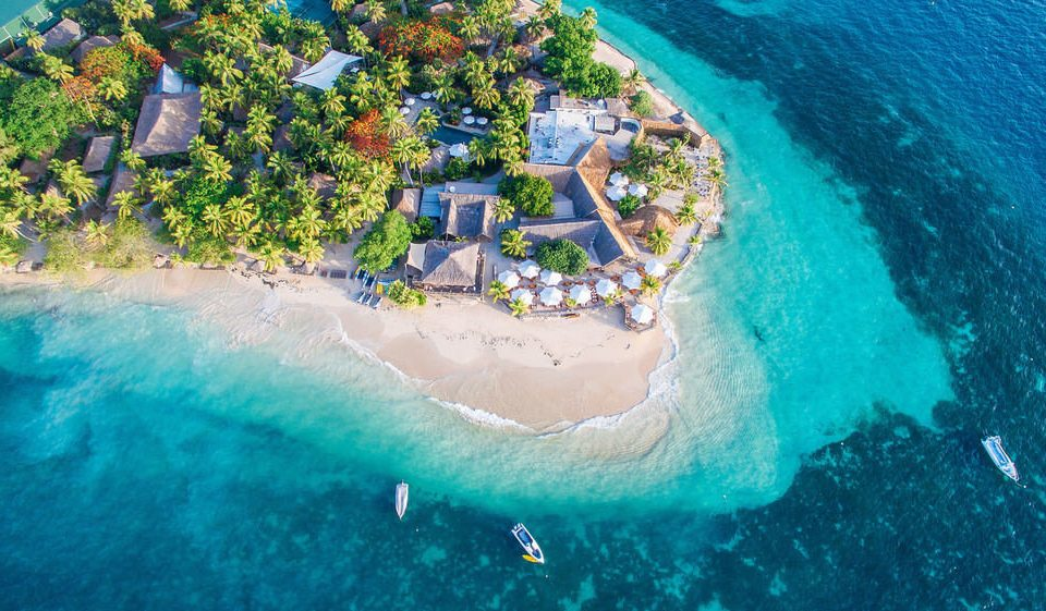 water Sea water sport aerial photography Ocean Coast caribbean swimming pool Island Beach cape terrain Water park Lagoon reef wave