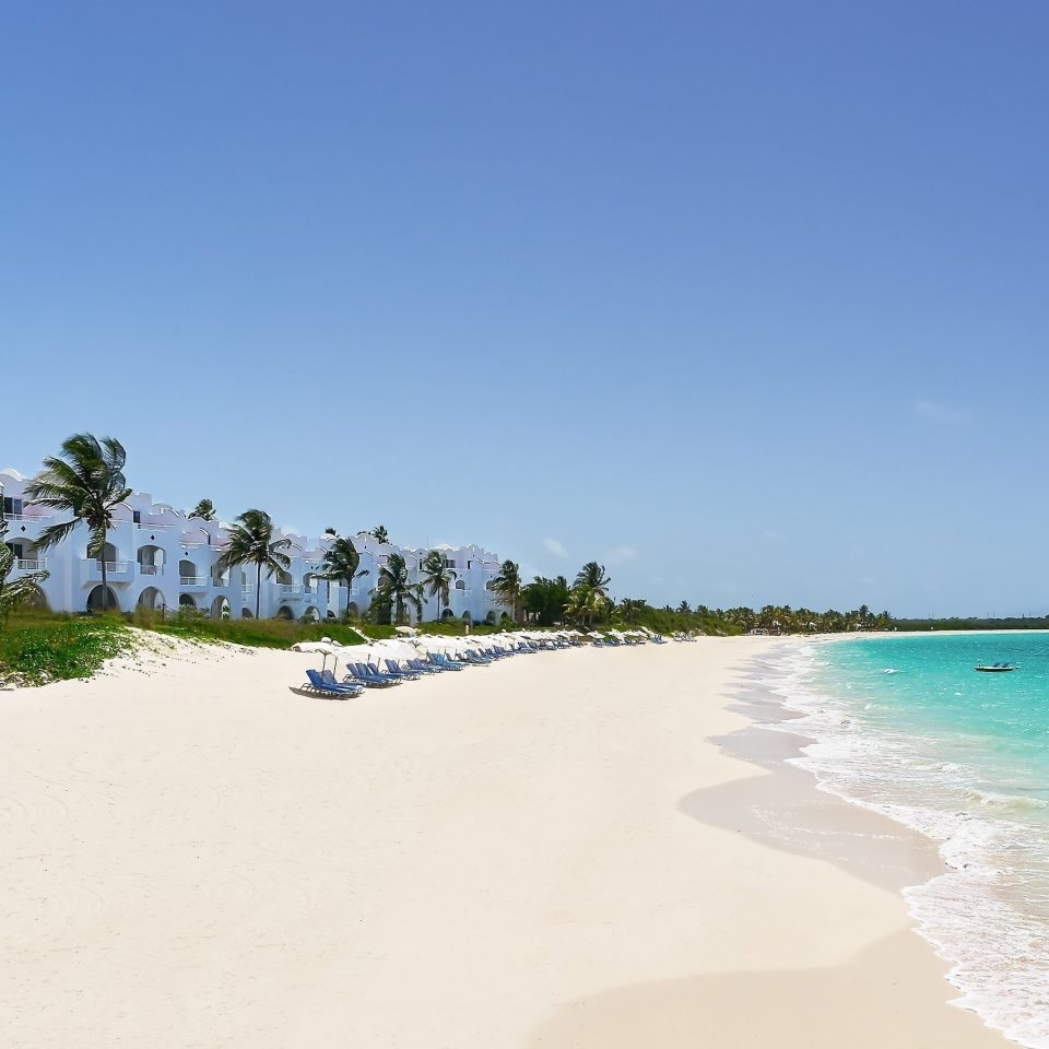 sky water Beach shore Sea Ocean caribbean Coast sand Nature Island Lagoon cape cay Resort blue sandy sunny day