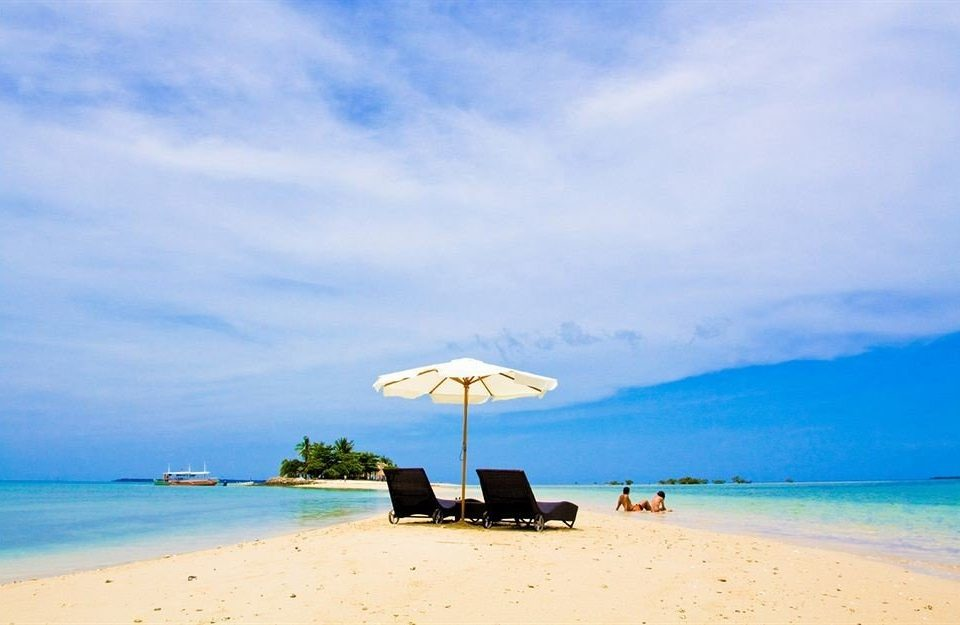 sky water umbrella Beach chair Nature Sea shore horizon Ocean caribbean Coast Island lawn Lagoon cape sand blue day sandy