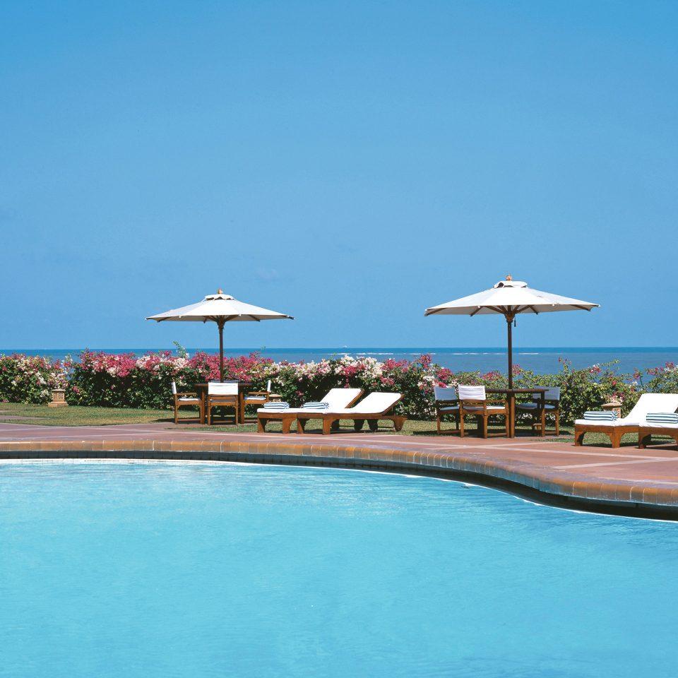 Lounge Patio Pool Terrace Waterfront sky water Sea swimming pool Ocean Beach horizon Coast blue shore marina Resort caribbean cape dock Lagoon swimming Island