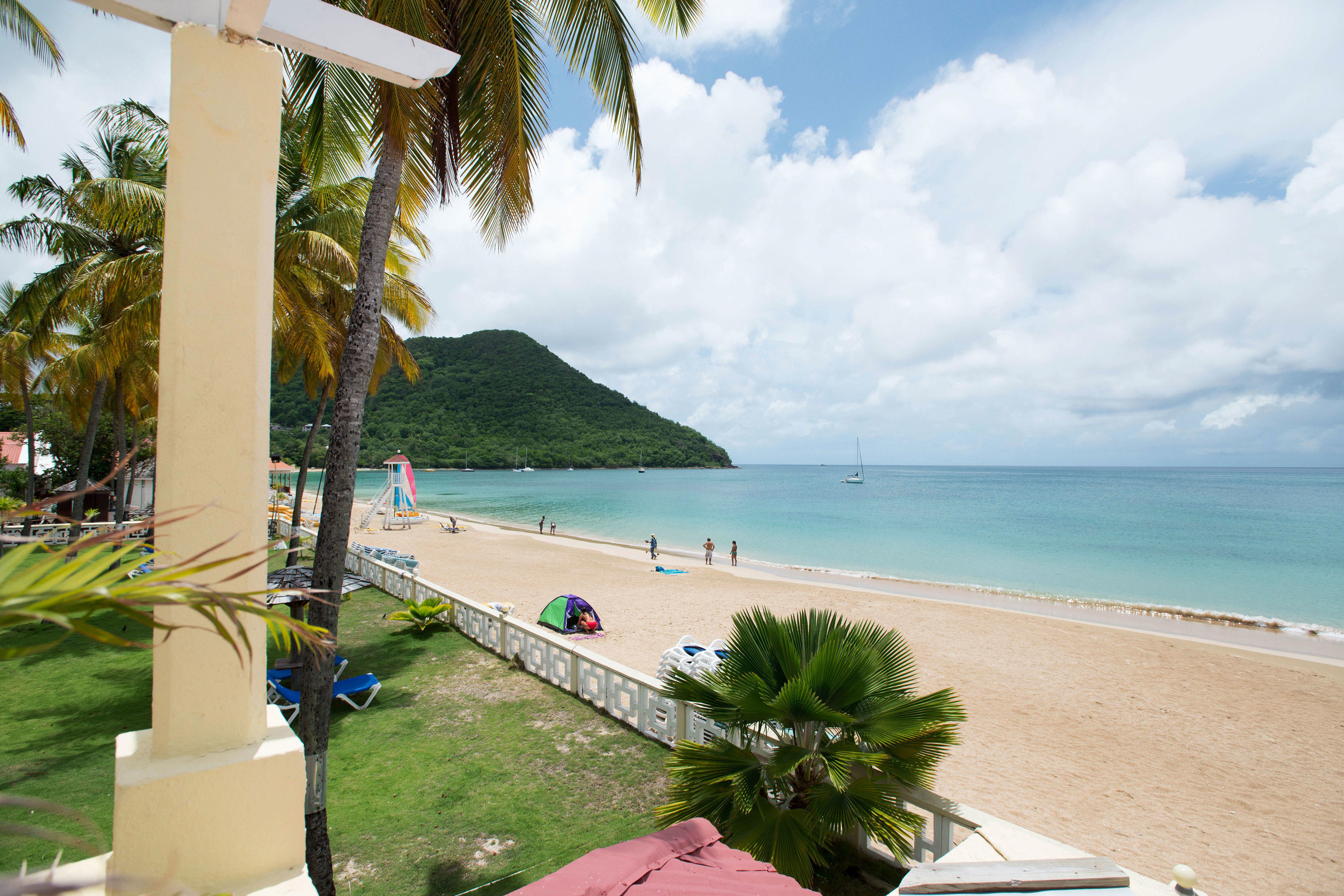 sky Beach caribbean Sea Ocean palm Coast shore Resort arecales tropics Nature cape swimming pool Villa lawn Lagoon Island cove lined plant shade day sandy
