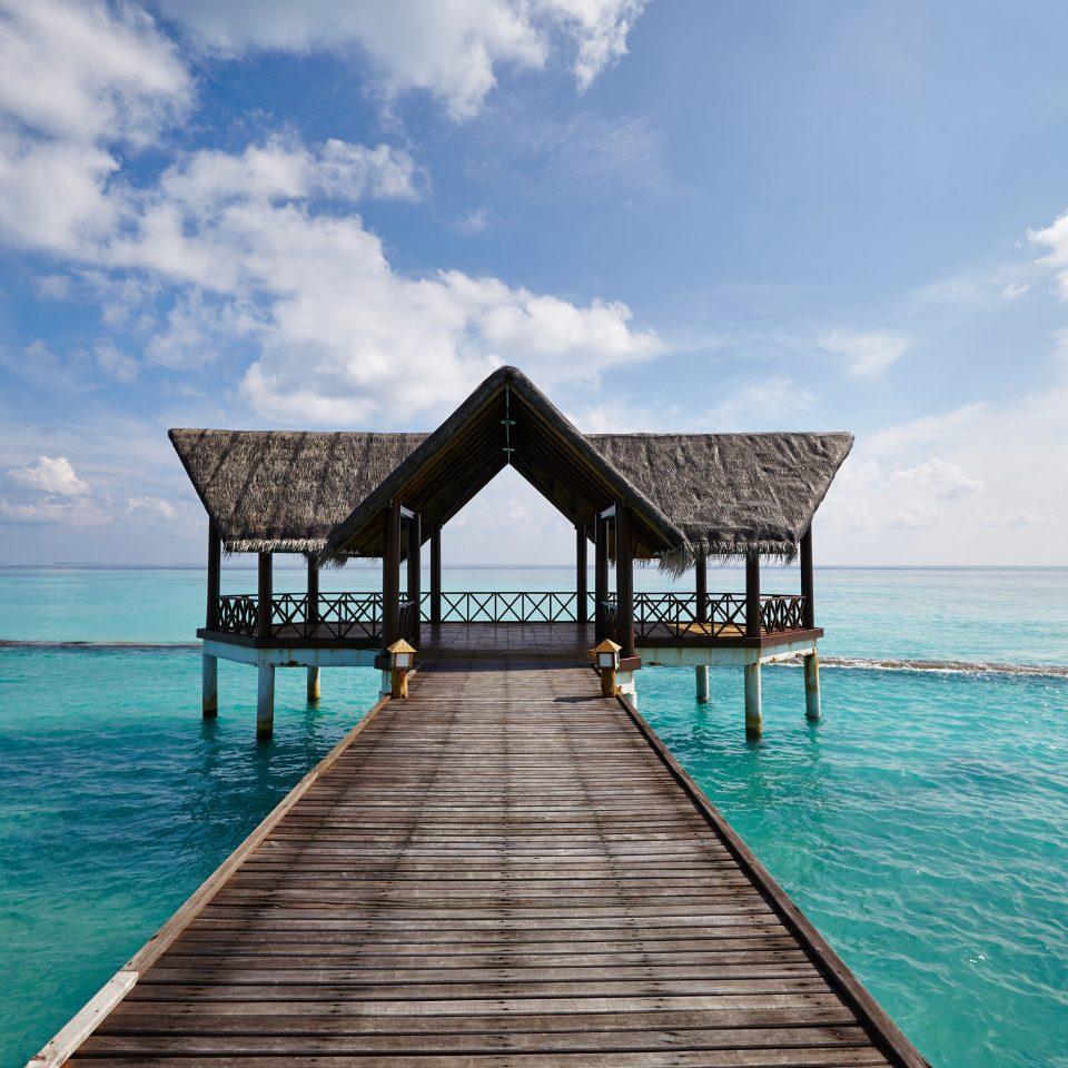 water sky Sea pier Ocean horizon Beach shore caribbean wooden Coast Island Lagoon Resort empty