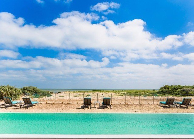 sky Beach shore property Sea athletic game Coast swimming pool Ocean caribbean Lagoon Resort Island cove sandy day