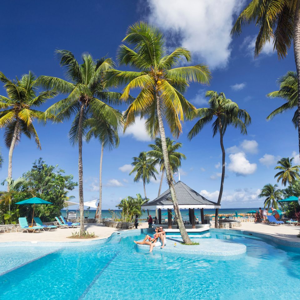 Resort leisure swimming pool tropics caribbean resort town palm tree arecales sky water tree coastal and oceanic landforms Sea Lagoon Beach Ocean Island Coast