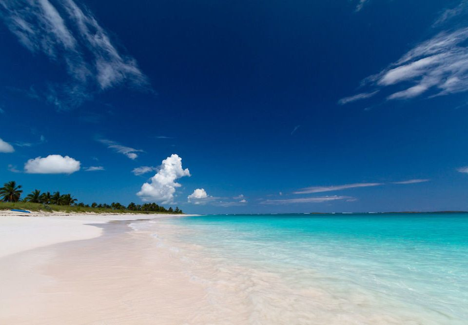 sky water Sea Nature Beach horizon cloud shore Ocean caribbean wind wave Coast wave Lagoon Island sunlight cape sand tropics blue swimming clouds day distance