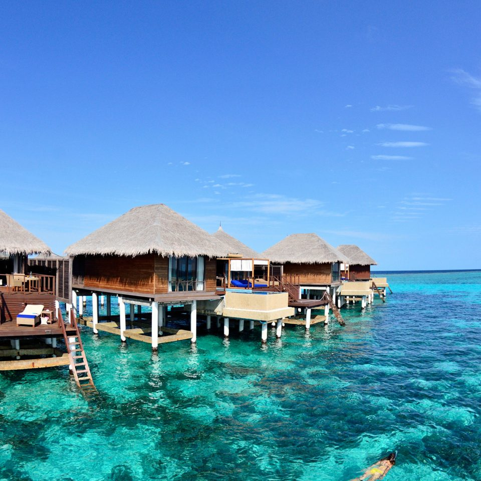 Island Luxury Overwater Bungalow Romance Romantic Waterfront sky water Sea Ocean Beach swimming pool caribbean shore Nature Lagoon Coast Resort cape vehicle cove blue swimming day