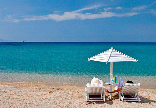 water sky Beach umbrella shore chair Sea Ocean caribbean Coast horizon Nature sand Island cape Lagoon