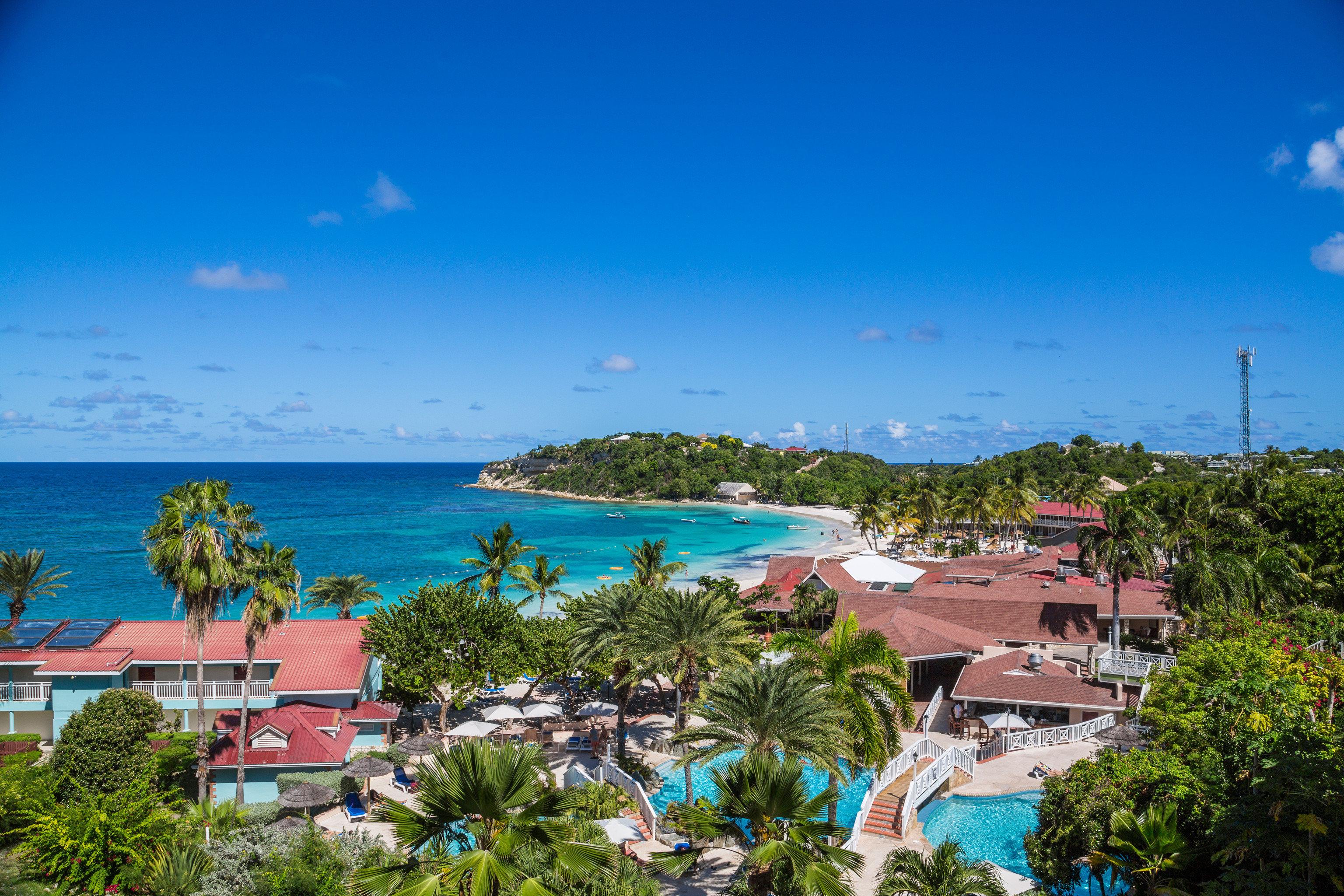 sky tree Beach Sea caribbean Resort Ocean Coast tropics lawn Island Lagoon overlooking beautiful