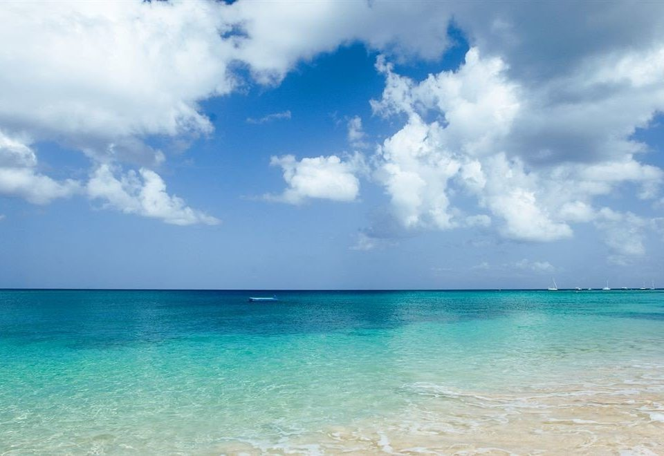 sky water Sea horizon Ocean shore cloud Beach blue caribbean wind wave wave Nature Coast tropics clouds sunlight Lagoon day cloudy sand Island cape swimming sunny sandy