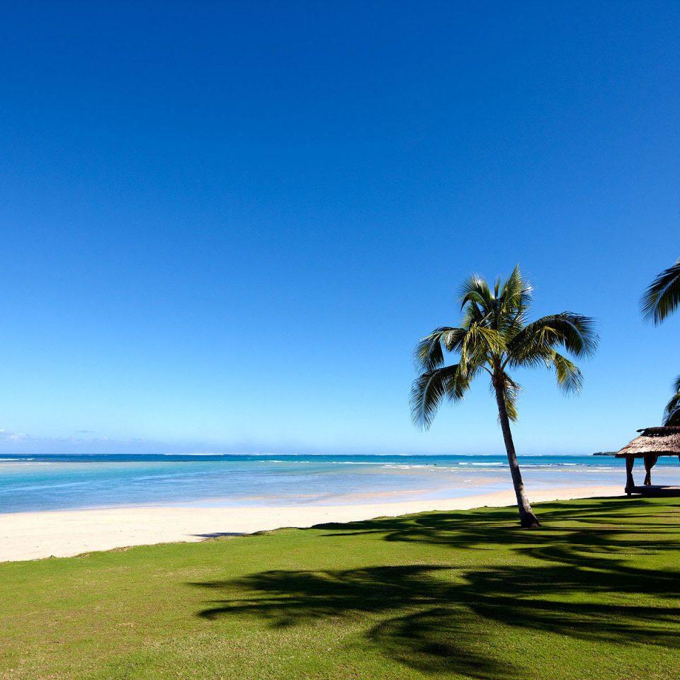 Beach Resort Scenic views sky water grass Ocean shore horizon tree Sea Coast Nature caribbean arecales palm overlooking tropics palm family cape Island Lagoon dusk plant