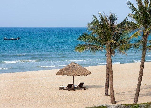 water sky Beach umbrella tree palm shore chair Nature Sea Ocean Coast caribbean arecales sandy cape tropics sand palm family Lagoon Island shade
