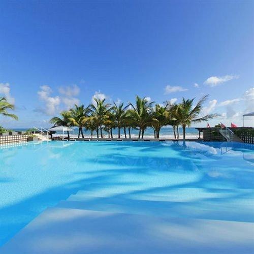 sky swimming pool caribbean Resort leisure blue Beach Ocean Sea Lagoon Nature atoll resort town Coast Island swimming shore day