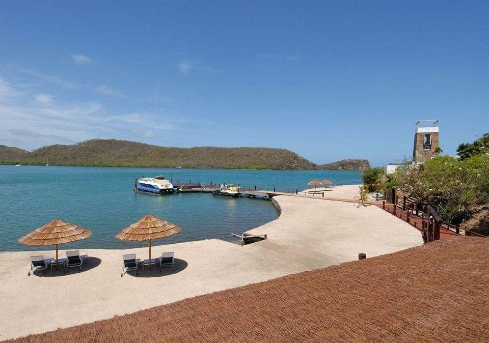 sky water property Sea Nature Beach Coast shore swimming pool cove Lagoon cape Villa lined Island day