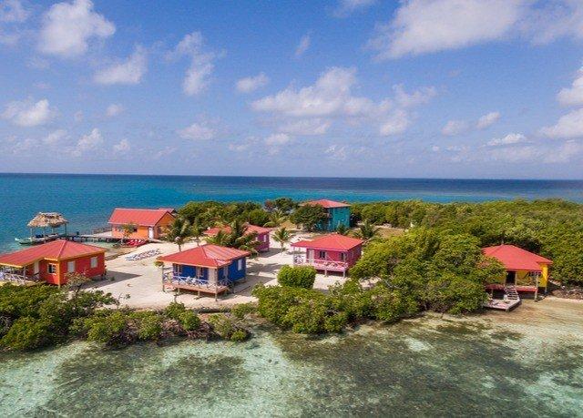 sky property caribbean Beach Coast Resort Nature Sea cove Island Lagoon shore day