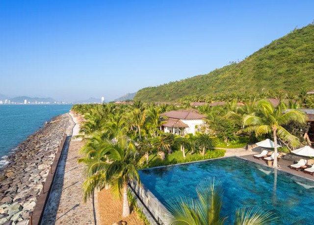 sky water property Resort Coast caribbean Sea swimming pool Lagoon Beach cove overlooking Island