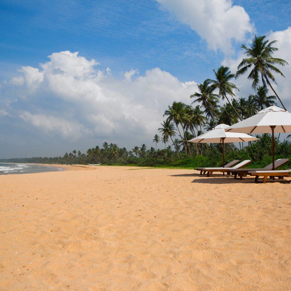sky ground Beach shore Sea Ocean Coast Nature sand sandy caribbean cape Island Lagoon tropics day