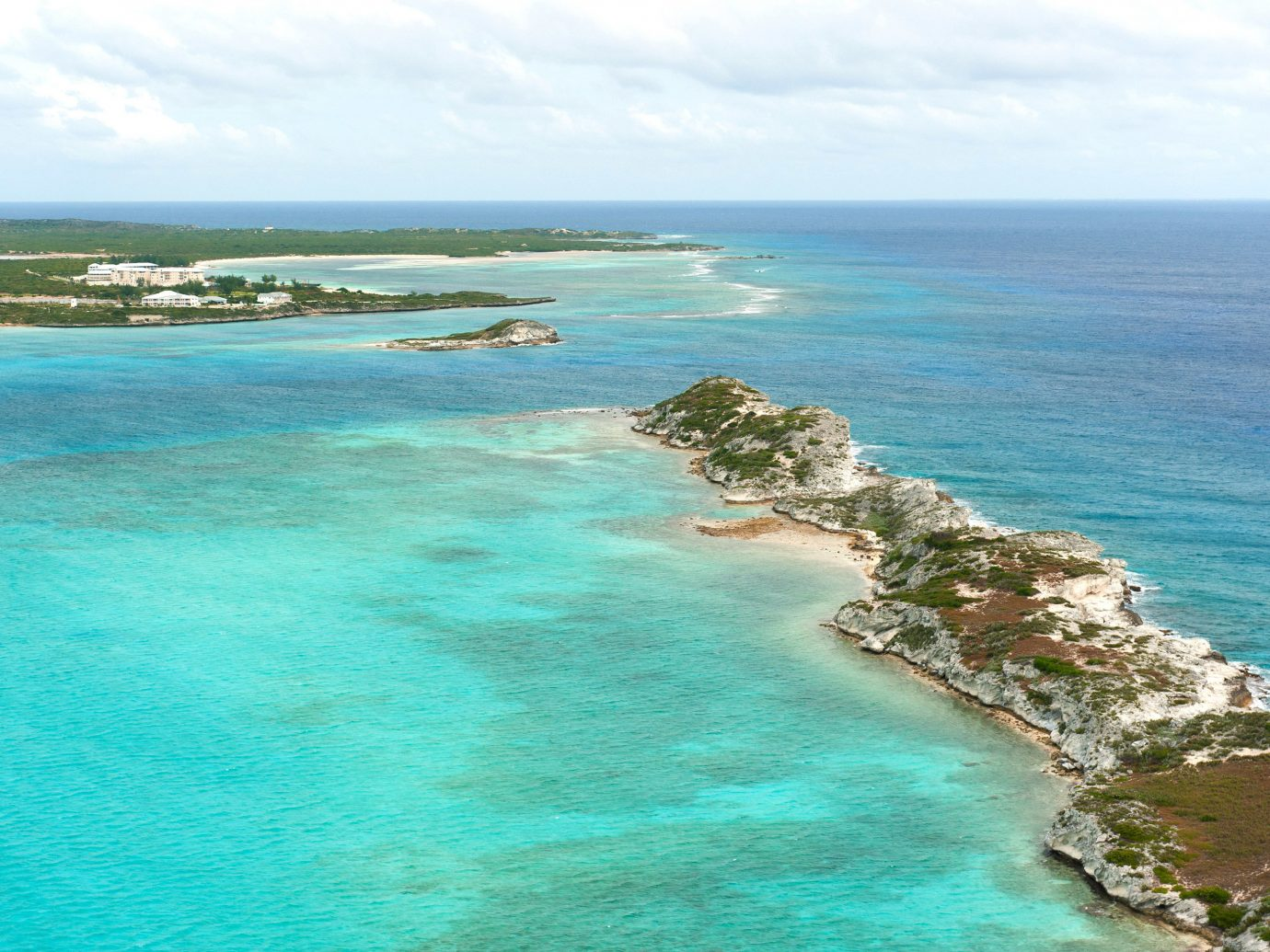 water sky Nature Ocean Sea Coast shore promontory Beach islet caribbean wind wave cape cliff cove terrain archipelago Island Lagoon blue wave reef