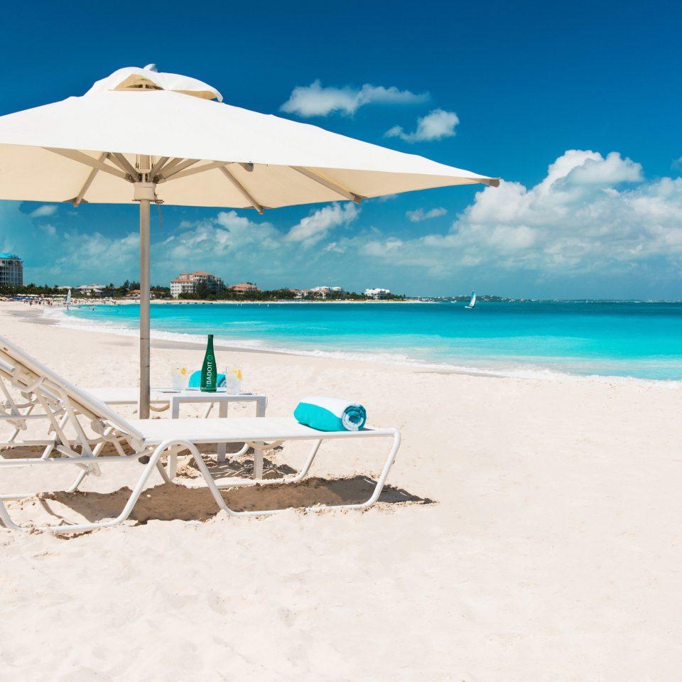 sky umbrella ground Beach Nature shore leisure Ocean caribbean Sea sand Coast Resort Lagoon Island sandy accessory day