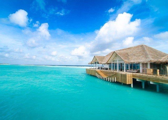 sky water Sea caribbean Ocean blue Beach horizon swimming pool shore Coast Island Lagoon Resort cape tropics islet Pool atoll cay swimming