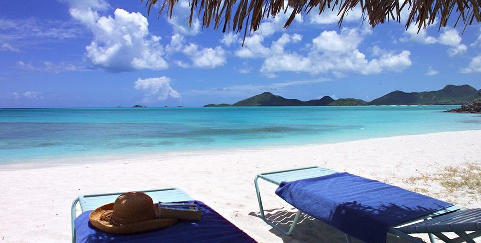 sky water Beach ground chair umbrella leisure caribbean Ocean Sea Coast Lagoon Island empty shore set lined shade day sandy