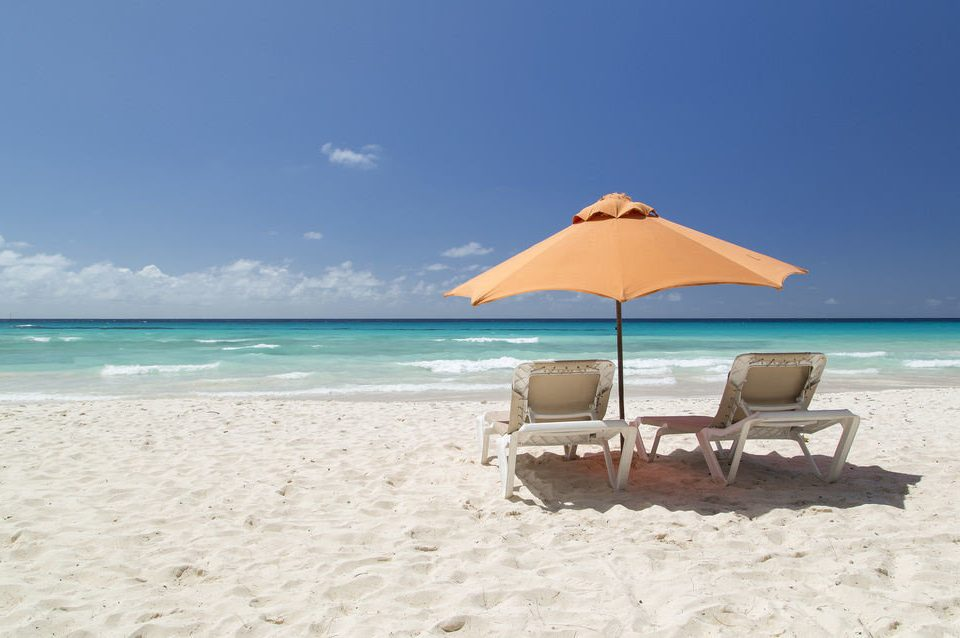 sky umbrella Beach water chair shore Nature Sea leisure Ocean caribbean sand Coast sun tanning Lagoon Island sandy