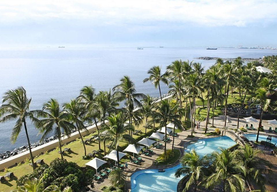 water sky tree Beach Resort caribbean Sea Coast arecales Nature Ocean tropics Lagoon plant Island shore