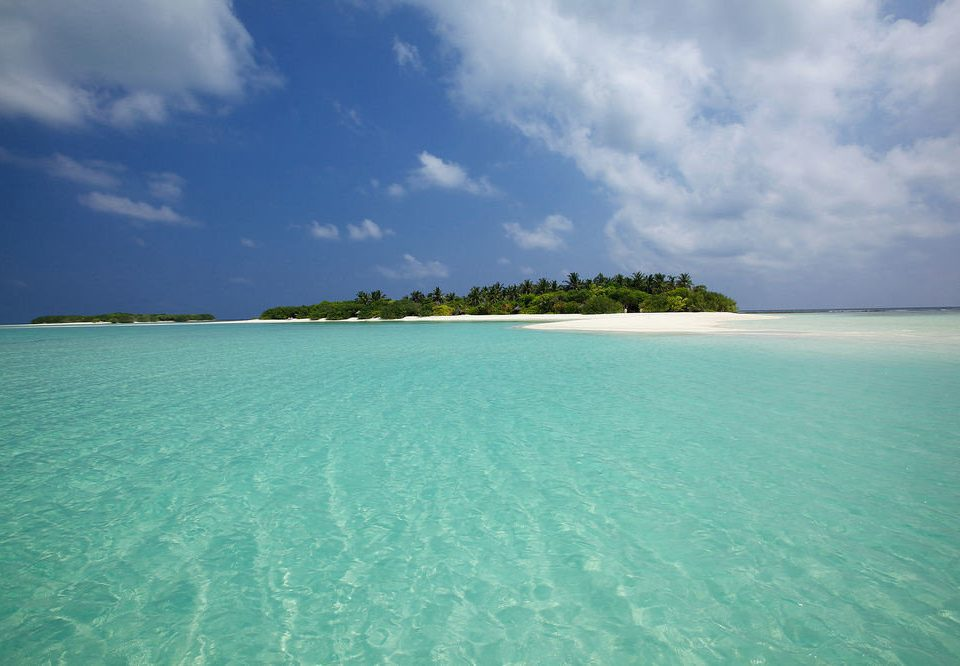 sky water Nature Sea Ocean horizon caribbean Beach reef islet Island Coast Lagoon archipelago clouds cape tropics cloudy atoll cay sand blue shore day distance