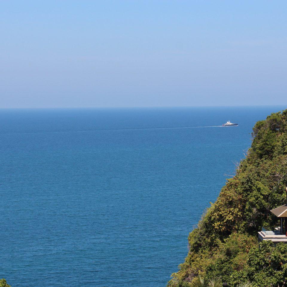 Luxury Nature Ocean Outdoors water sky Sea Coast shore promontory horizon cliff cape terrain Beach cove islet Island distance