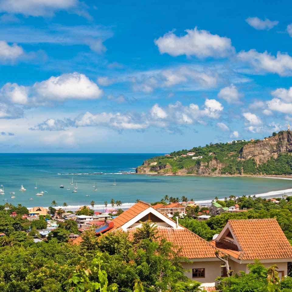 Beach Luxury Rustic Scenic views Tropical sky Sea Coast shore horizon Nature Ocean caribbean landscape cape cove Island clouds
