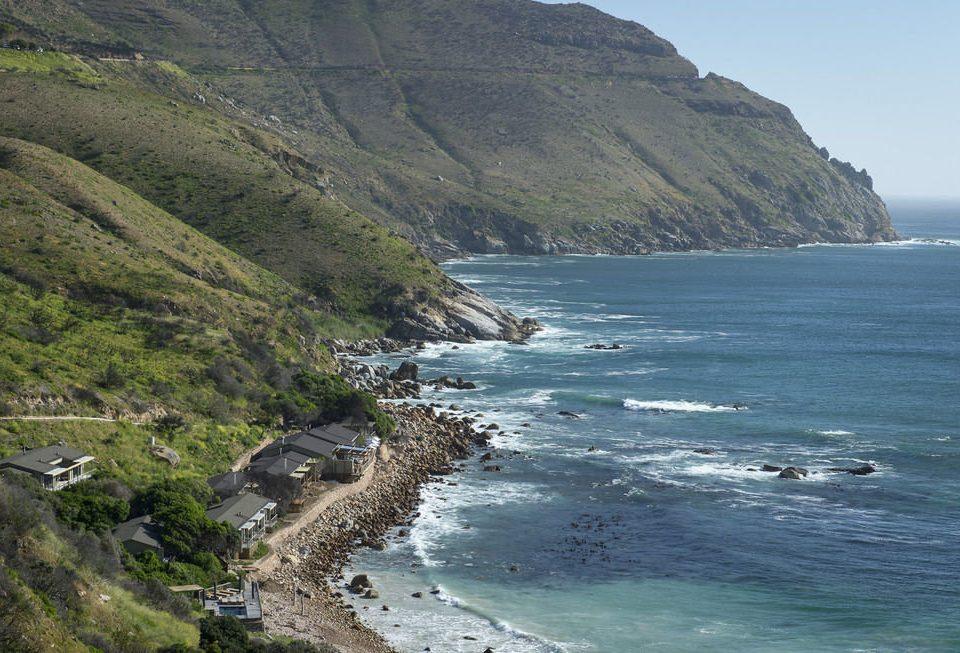 mountain Nature water sky Coast Sea cliff shore Ocean rock Beach terrain cape rocky cove fjord promontory hillside Island