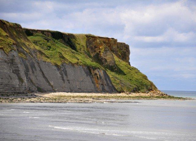 sky mountain cliff Coast Nature shore Beach Sea headland Ocean terrain rock cove cape badlands islet wave stack Island geology
