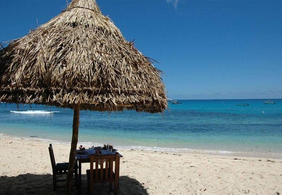 sky water Beach umbrella chair Sea shore Ocean Coast Nature lawn cape sand Island islet caribbean sandy day