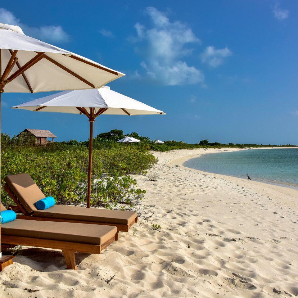 sky umbrella Beach chair Nature Sea caribbean shore Ocean Coast Resort accessory Island cape tropics day set shade sandy