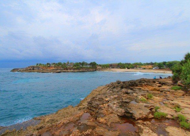 sky water shore Coast Nature Sea Beach cove cliff inlet terrain cape Island sandy