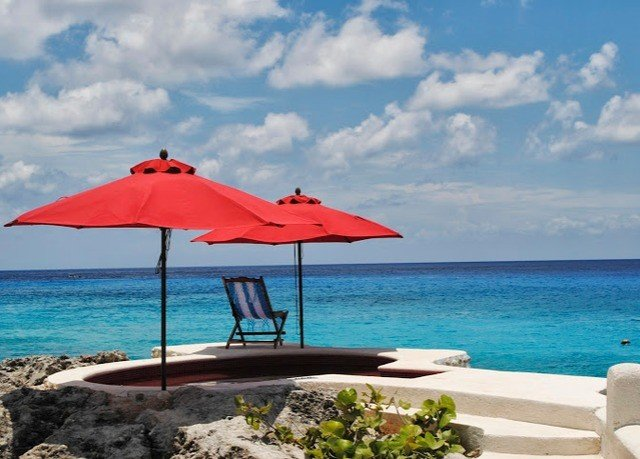 umbrella sky water chair Beach Nature Sea Ocean lawn shore caribbean Coast vehicle Island day