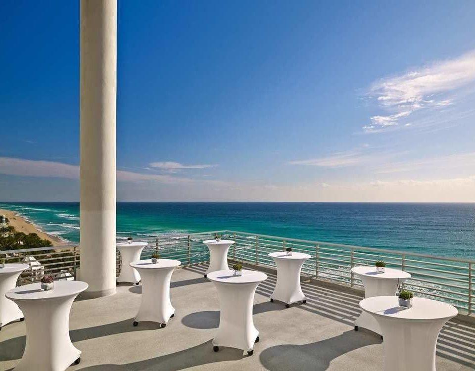 sky water Ocean Sea property chair Beach caribbean horizon Coast marina Nature Resort shore cape dock Villa yacht overlooking lined Island