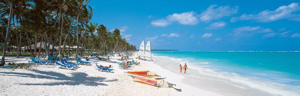 sky Beach water Nature shore Sea caribbean Ocean Resort Coast vehicle Island boating lined sandy enjoying swimming day