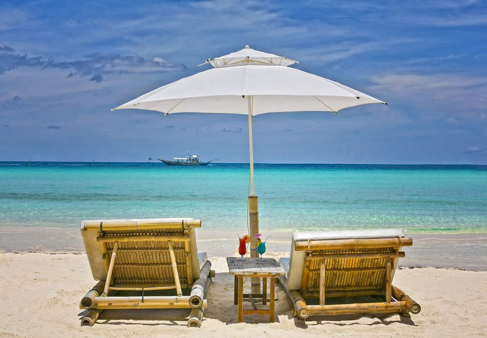 sky water Beach umbrella chair Sea Nature Ocean shore caribbean Coast Island cape sand Resort sandy day