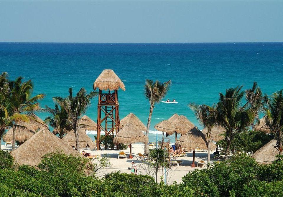 sky water Beach Nature Sea Ocean house caribbean Coast Resort arecales cape tropics shore palm distance Island